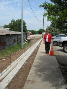 Carolyn McDowell, Friends President, with New Fence
